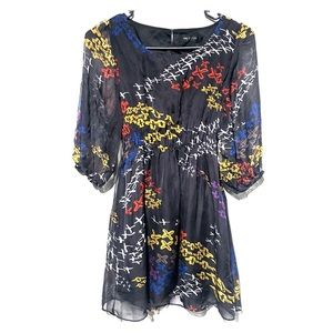 M.M Couture print . Size small